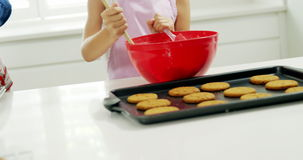 Girl mixing dough in bowl stock footage