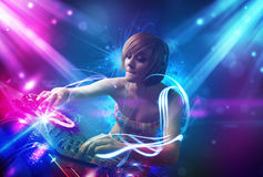 Girl mixing music with powerful light effects Stock Photography