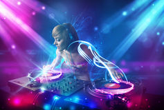 Girl mixing music with powerful light effects Stock Images