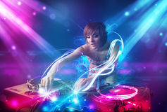 Girl mixing music with powerful light effects Stock Photos