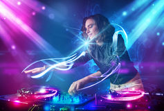 Girl mixing music with powerful light effects Royalty Free Stock Photography