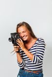 Girl with an 8mm retro movie camera Royalty Free Stock Images
