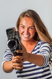 Girl with an 8mm retro movie camera Stock Photos