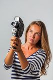 Girl with an 8mm retro movie camera Royalty Free Stock Photo