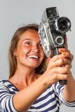 Girl with an 8mm retro movie camera Stock Photography