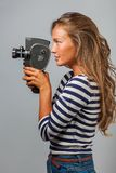 Girl with an 8mm retro movie camera Stock Photo