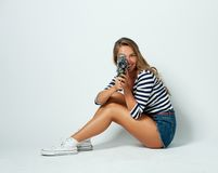 Girl with an 8mm retro movie camera Royalty Free Stock Photography