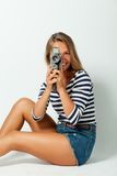 Girl with an 8mm retro movie camera Royalty Free Stock Photos