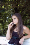 Girl with mobile outdoors royalty free stock images