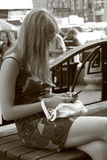 Girl with the mobile phone Stock Images