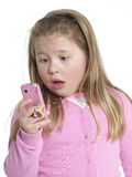 Girl with a mobile phone. Little girl having fun with a mobile phone Stock Images