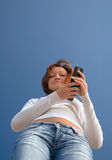Girl with a mobile phone-2. With a phone Royalty Free Stock Images