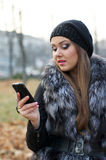 Girl with a mobile phone Royalty Free Stock Photo