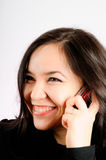 The girl with a mobile phone. The happy girl with a mobile phone Stock Photography
