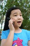 Girl on mobile phone. Girl talking on mobile phone in the park Stock Photos
