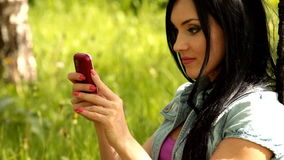 Girl  mobile phone Stock Images