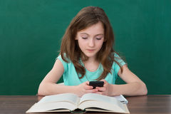 Girl With Mobile Phone And Books Stock Photo
