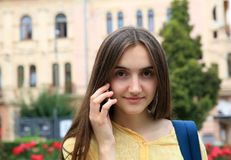 Girl with mobile phone in the city. Stock Image
