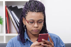 Girl with mobile phone. Female young african descent with the phone mobile Stock Photos