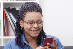 Girl with mobile phone. Female young african descent with the phone mobile Stock Photography