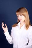 girl with a mobile phone in a hand, a  blue back Royalty Free Stock Photo