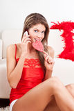 Girl with mobile phone and lollipop Royalty Free Stock Images