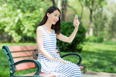 Girl and mobile phone Royalty Free Stock Image