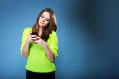 Girl with mobile phone reads message Royalty Free Stock Photo