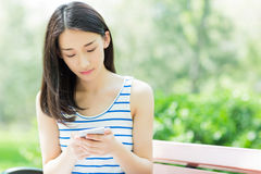 Girl and mobile phone Royalty Free Stock Photo
