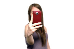Girl with mobile phone. Young woman is taking photos with the mobile phone camera Royalty Free Stock Photo