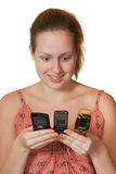 Girl with mobile phones Stock Photography