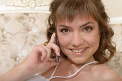 Girl with mobile telephone Stock Photography