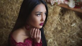 Beautiful girl with dark hair looks in frame stock footage