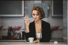 Girl model with a cigarette looks straight Royalty Free Stock Photo