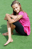 Girl. Model posing on the background of sports field Stock Photo