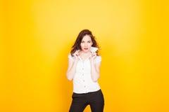 Girl model posing in the Studio yellow. Happy girl model posing in the Studio yellow stock images