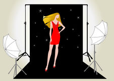 Girl model in red on the photo shoot Stock Photos