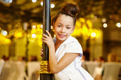 Girl-model stands, leaning decorative lamppost Royalty Free Stock Images