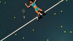 Girl model on the tennis court.  stock footage