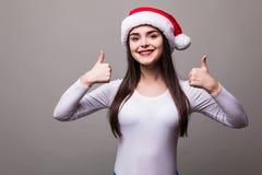 Girl model wear santa hat with okey gesture Stock Photos