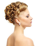 Girl with modern hairstyle isolated on a white Stock Image