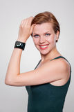 Girl with a modern Internet Smart Watch on grey ba Stock Image