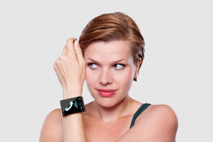 Girl with a modern Internet Smart Watch on grey background royalty free stock photos