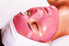 Girl with moistening fruit facial mask Stock Photography