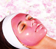 Girl with moistening fruit facial mask Royalty Free Stock Photos