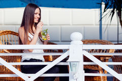 Girl with mojito in cafe Royalty Free Stock Photography