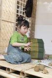 Girl molding clay figurine Royalty Free Stock Photo