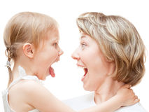 Girl with mom. Portrait of a girl with her mom shouting on each other isolated on white Stock Photo