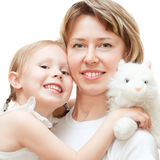 Girl with mom. High key portrait of a little girl with her mom isolated on white Stock Photos