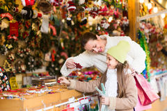 Girl with mom buying decorations Royalty Free Stock Image